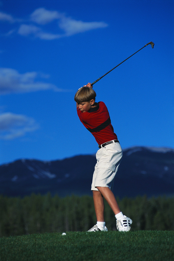Young Golfer Making Swing